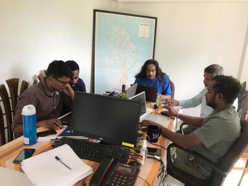 Research team study field and satellite data