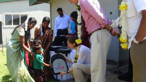 MAS-creche-US-officials-distributing-school-kits-to-farmer-children
