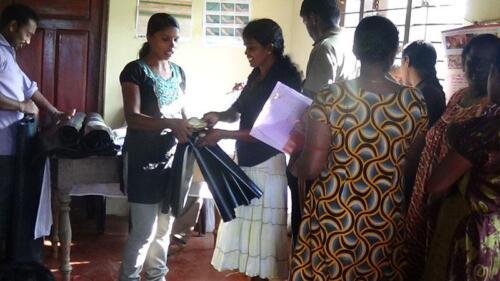 Neethypuram-Volunteers-handing-over-the-inputs-to-beneficiary